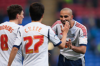 Football - 2012 / 2013 FA Cup - Bolton Wanderers vs. Sunderland<br /> Darren Pratley congratulates Lee Chung-Yong of Bolton at the Reebok Stadium