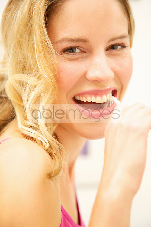 Smiling Woman Brushing Teeth