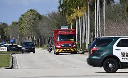 An ambulance leaves the rear entrance of Marjory Stoneman Douglas High School in Parkland, Thursday, February 15, 2018. Photo by Joe Cavaretta/Sun Sentinel/TNS/ABACAPRESS.COM