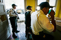 Nuevo Laredo, Tamaulipas, Mexico --Municipal Police officers take no chances while stopping for lunch. While other officers eat, another stands watching the streets armed with an AR-15 automatic weapon in the volatile Mexican border town just across the Rio Grand River from Laredo, Texas. Officers were recently gunned down while eating in restaurants and Mexican federal investigators were recently gunned down in the vehicle during broad daylight in town. -- Photo by Jack Gruber, USA TODAY