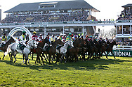 The jockeys try getting them into a line for the start of the 5:15pm The Randox Health Grand National Steeple Chase (Grade 3) 4m 2f during the Grand National Meeting at Aintree, Liverpool, United Kingdom on 6 April 2019.