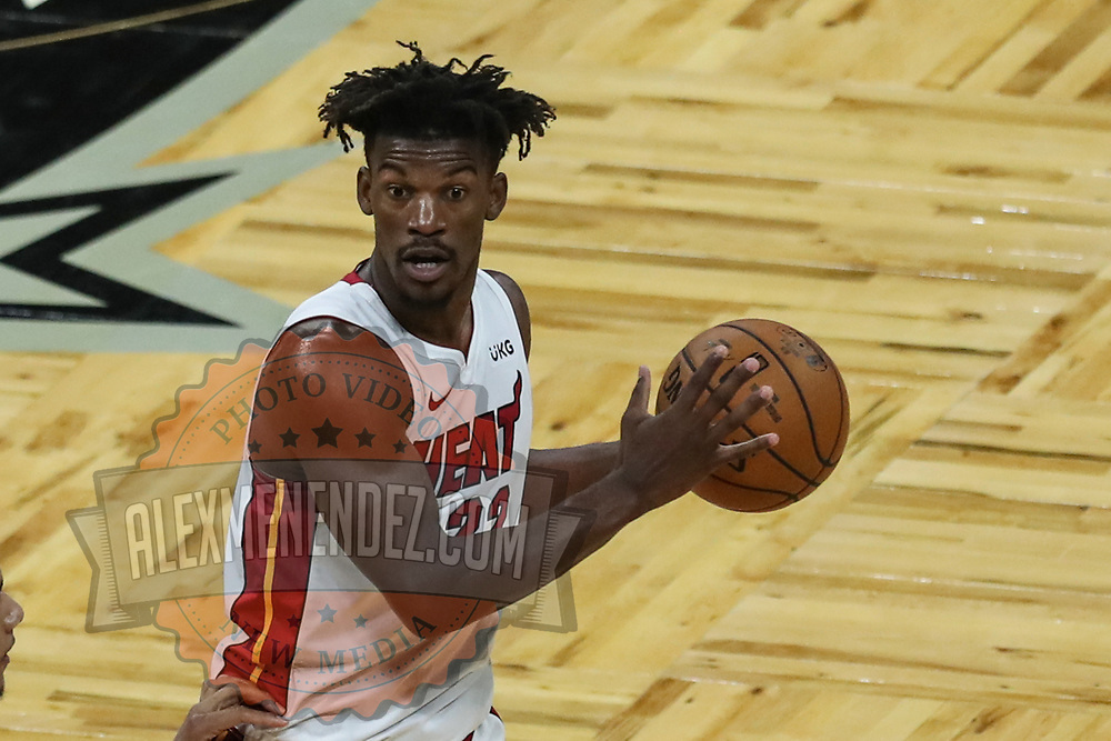 ORLANDO, FL - MARCH 14: Jimmy Butler #22 of the Miami Heat controls the ball against the Orlando Magic at Amway Center on March 14, 2021 in Orlando, Florida. NOTE TO USER: User expressly acknowledges and agrees that, by downloading and or using this photograph, User is consenting to the terms and conditions of the Getty Images License Agreement. (Photo by Alex Menendez/Getty Images)*** Local Caption *** Jimmy Butler