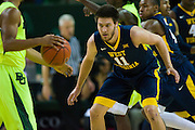 WACO, TX - MARCH 5: Nathan Adrian #11 of the West Virginia Mountaineers defends against the Baylor Bears on March 5, 2016 at the Ferrell Center in Waco, Texas.  (Photo by Cooper Neill/Getty Images) *** Local Caption *** Nathan Adrian