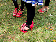 Hmong Der (White Hmong) women wearing contemporary Hmong traditional costume at Ban Km 52 Hmong New Year festival, Vientiane province, Lao PDR. The Hmong celebration of New Year is based on the lunar calendar. This important time is an opportunity to honour ancestors and spirits through offerings and rituals and to partake in games, sports, feasts, shows, bullfights and courtship. The Hmong are the third largest ethnic group in Laos. One of the most ethnically diverse countries in Southeast Asia, Laos has 49 officially recognised ethnic groups although there are many more self-identified and sub groups. These groups are distinguished by their own customs, beliefs and rituals.