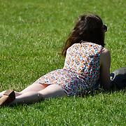 London, UK. 27 June 2019. UK Weather - People Suntan at the Hottest week in June 2019 at St James park, London, UK