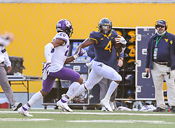 Nov 14, 2020; Morgantown, West Virginia, USA; West Virginia Mountaineers running back Leddie Brown (4) runs the ball during the fourth quarter against the TCU Horned Frogs at Mountaineer Field at Milan Puskar Stadium. Mandatory Credit: Ben Queen-USA TODAY Sports