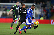 Gaetan Bong of Brighton & Hove Albion (l) challenges Junior Hoilett of Cardiff city.EFL Skybet championship match, Cardiff city v Brighton & Hove Albion at the Cardiff city stadium in Cardiff, South Wales on Saturday 3rd December 2016.<br /> pic by Andrew Orchard, Andrew Orchard sports photography.