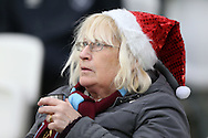 a West Ham United fan wearing a Christmas hat looks on. Premier league match, West Ham Utd v Hull city at the London Stadium, Queen Elizabeth Olympic Park in London on Saturday 17th December 2016.<br /> pic by John Patrick Fletcher, Andrew Orchard sports photography.