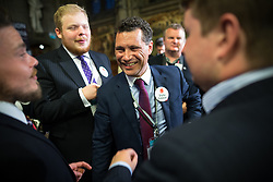 © Licensed to London News Pictures . FILE PICTURE DATED 24/06/2016 of STEVEN WOOLFE (c) celebrating the Brexit result with fellow UKIP supporters , at Manchester Town Hall , UK , after the count in the EU referendum , as today , 14th July 2016 , Woolfe has declared his intention to stand as the next leader of UKIP , following the resignation of Nigel Farage . Photo credit : Joel Goodman/LNP