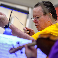 Sam Pemberton conducts the Red Rock String Ensemble during rehearsal at Miyamura High School in Gallup Sunday.