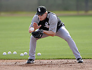 GLENDALE, AZ - FEBRUARY 24:  Gordon Beckham #15 of the Chicago White Sox fields a ground ball while playing second base during a workout on February 24, 2010 at the White Sox training facility at Camelback Ranch in Glendale, Arizona. (Photo by Ron Vesely)