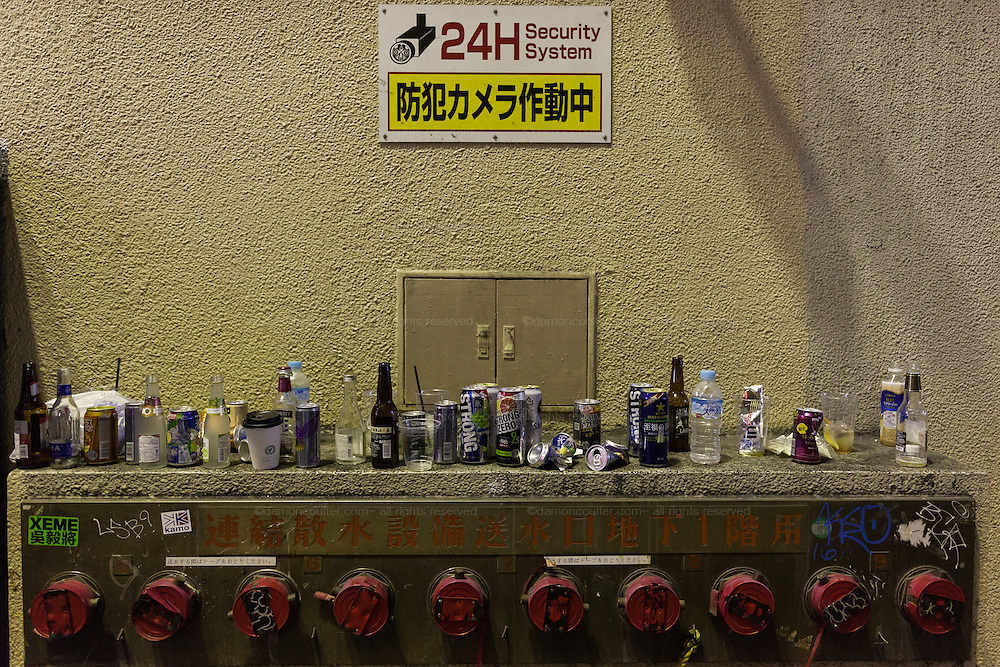 Discarded alcohol can and bottles during the Halloween celebrations in Shibuya, Tokyo, Japan. Saturday October 29th 2016 Halloween celebration in Japan have grown massively in the last few years. To ensure the safety of the crowds in Shibuya this year, the police closed several roads leading to the famous Hachiko Square, allowing costumed revellers to spread over a larger area.