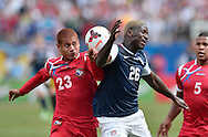 Panama defender Roberto Chen (L) and United States forward Eddie Johnson go for the ball during the second half of the 2013 CONCACAF Gold Cup Final at Soldier Field in Chicago on July 28, 2013. The United States won 1-0. (UPI)