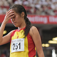 Jezebel Koh Xin Yun (#251) of Hwa Chong Institution reacting after one of her jumps. (Photo 1 © Stefanus Ian/Red Sports)