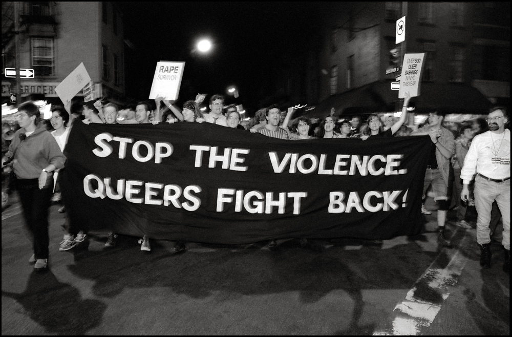 """Queer Nation activists march through the East Village at a """"Take Back the Night"""" march in New York City on June 22, 1991."""