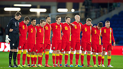11.10.2013, City Stadion, Cardiff, WAL, FIFA WM Qualifikation, Wales vs Mazedonien, Gruppe A, im Bild Wales' players stand for a minute's silence to remember FAW Council Member Tegwyn Evans who passed away earlier in the week, before the 2014 FIFA World Cup Brazil Qualifying Group A match against Macedonia at the Cardiff City Stadium. Left to right: goalkeeper Wayne Hennessey, Chris Gunter, Neil Taylor, David Vaughan, Hal Robson-Kanu, Andy King, Aaron Ramsey, James Collins, Simon Church, Declan John, Craig Bellamy.the FIFA World Cup Qualifier Group A Match between Wales and Macedonia at the City Stadium, Cardiff, Wales on 2013/10/11. EXPA Pictures © 2013, PhotoCredit: EXPA/ Propagandaphoto/ David Rawcliffe<br /> <br /> ***** ATTENTION - OUT OF ENG, GBR, UK *****