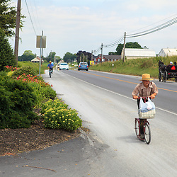 An Amish boy uses a bike on the Old Philadelphia Pike in Lancaster County, PA.