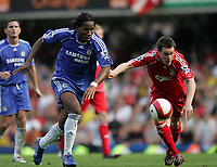 Photo: Lee Earle.<br /> Chelsea v Liverpool. The Barclays Premiership. 17/09/2006. Chelsea's Didier Drogba (L) and Steve Finnan chase the ball.