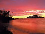 Dramatic Fiery Sunset and Breaking Storm Over Deception Pass, San Juan Islands, Washington
