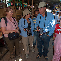 Travelers explore the crowded outdoor market in Belem, a neighborhood of Iquitos, Peru.