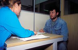 Interviewing refugee, Asylum Seekers Reception Centre Haringey, London UK