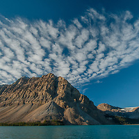 Dramatic clouds soar over Crowfoot Mountain and Bow Lake in Banff National Park, Alberta, Canada.  On the right is Mount Thompson.