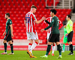 Nathan Collins of Stoke City and Son Heung-Min of Tottenham Hotspur congratulate one another after the final whistle  - Mandatory by-line: Nick Browning/JMP - 23/12/2020 - FOOTBALL - Bet365 Stadium - Stoke-on-Trent, England - Stoke City v Tottenham Hotspur - Carabao Cup