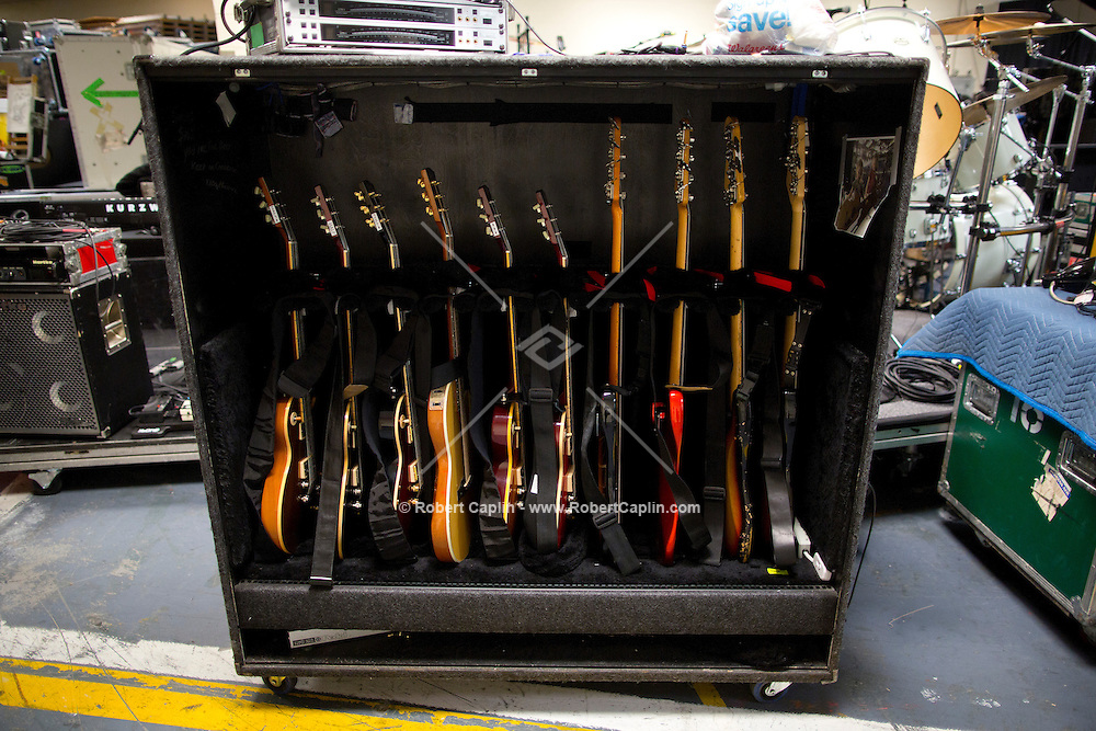 """Guitars in road cases backstage. """"12-12-12?, a fundraising concert to aid the victims of Hurricane Sandy, will take place on December 12, 2012 at Madison Square Garden. The concert featured The Rolling Stones, Bon Jovi, Eric Clapton, Dave Grohl, Billy Joel, Alicia Keys, Chris Martin, Bruce Springsteen & the E Street Band, Eddie Vedder, Roger Waters, Kanye West, The Who, and Paul McCartney. All the proceeds went go to the Robin Hood Relief Fund. Robin Hood, the largest independent poverty fighting organization in the New York area, will insure that every cent raised will go to non-profit groups that are helping the tens of thousands.of people throughout the tri-state area who have been affected by Hurricane Sandy...Photo © Robert Caplin.."""