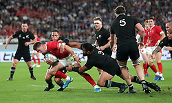 Wales' Josh Adams is tackled by New Zealand's Nepo Laulala and Aaron Smith during the 2019 Rugby World Cup bronze final match at Tokyo Stadium.