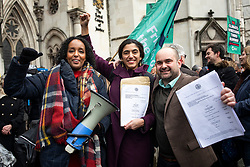 © Licensed to London News Pictures. 27/02/2020. London, UK. Friends of the Earth lawyers Katie de Kauwe (C) and Willian Rundle (R) hold copies of the court ruling as they celebrate outside the High Court. Judges have ruled that the planned expansion of Heathrow Airport is illegal over climate change. Photo credit: Rob Pinney/LNP