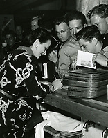 1943 Hedy Lamar signing autographs at the Hollywood Canteen
