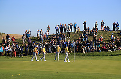 Team Europe's Rory McIlroy, Ian Poulter, Thorbjorn Olesen and Francesco Molinari during preview day four of the Ryder Cup at Le Golf National, Saint-Quentin-en-Yvelines, Paris.
