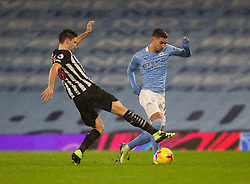 Ferran Torres of Manchester City (R) gets away from Federico Fernandez of Newcastle United - Mandatory by-line: Jack Phillips/JMP - 26/12/2020 - FOOTBALL - Etihad Stadium - Manchester, England - Manchester City v Newcastle United - English Premier League