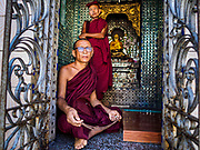 18 NOVEMBER 2017 - YANGON, MYANMAR: Buddhist monks at Botataung Pagoda in Yangon. Pope Francis is visiting Myanmar, September 27-30. It will be the first visit by a Pope to the overwhelmingly Buddhist nation. He will meet with the Aung San Suu Kyi and other political leaders and will participate in two masses in Yangon. The Pope is expected to talk about Rohingya issue while he is in Myanmar. The Rohingya are persecuted Muslim minority in Rakhine state in western Myanmar. It's not clear how Myanmar's politically powerful nationalist monks will react if the Pope openly talks about the Rohingya. In the past, the monks have led marches and demonstrations against foreign diplomatic missions when foreign ambassadors have spoken in defense of the Rohingya. There is not much visible sign of the Pope's imminent visit in Yangon, which is estimated to be more than 90% Buddhist.    PHOTO BY JACK KURTZ