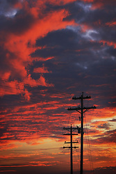July 21, 2019 - Telephone Poles Silhouetted Against A Cloudy Sky (Credit Image: © Richard Wear/Design Pics via ZUMA Wire)