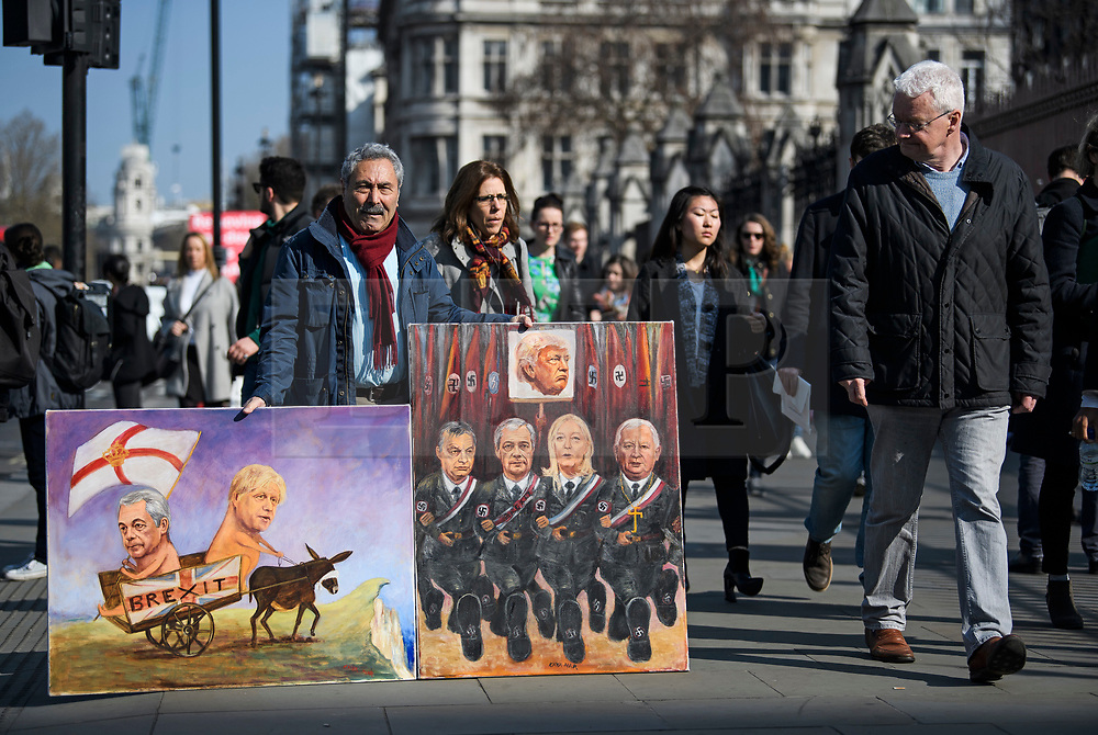 © Licensed to London News Pictures. 29/03/2019. London, UK. Satirical artist KAYA MAR holds up artwork outside parliament in Westminster, London. MPs will later vote on the withdrawal agreement, which sets out the terms of the UK's departure from the EU. Photo credit: Ben Cawthra/LNP
