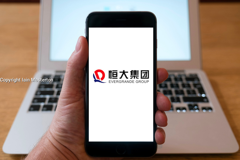 Evergrande Chinese conglomerate company logo on website on smart phone screen.