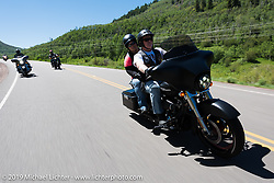 Rusty Ruff of Vernal, UT andmember of the High Unitas HOG chapter with Jenn Tucker of Roosevelt, UT on Rusty's 2011 Street Glide riding the 20 Mile Road in Steamboat Springs during the Rocky Mountain Regional HOG Rally, Colorado, USA. Saturday June 10, 2017. Rusty works in the oil fields and Jenn is an elementary school principle. Photography ©2017 Michael Lichter.