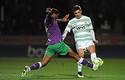 Yeovil Town's is tackled by Bristol City's Mark Little - Photo mandatory by-line: Harry Trump/JMP - Mobile: 07966 386802 - 10/03/15 - SPORT - Football - Sky Bet League One - Yeovil Town v Bristol City - Huish Park, Yeovil, England.
