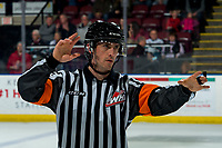 KELOWNA, BC - MARCH 6: Referee Bryan Bourdon stands on the ice and signals the bench of the Kelowna Rockets against the Seattle Thunderbirds at Prospera Place on March 6, 2020 in Kelowna, Canada. (Photo by Marissa Baecker/Shoot the Breeze)
