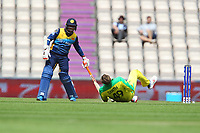 Cricket - 2019 ICC Cricket World Cup warm ups - Australia vs. Sri Lanka<br /> <br /> Steve Smith of Australia rolls on the floor after failing to catch a low ball whilst bowling only to take a hit to the groin during the cricket world cup warm up match at the Hampshire Bowl Southampton England<br /> <br /> COLORSPORT/SHAUN BOGGUST