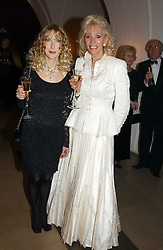 Left to right, BASIA BRIGGS and BARBARA de GEORGIOU at a private dinner to unveil the Van Cleef & Arpels jewellery collection 'Couture' with fashion by Anouska Hempel Couture held at The Banqueting House, Whitehall Palace, London on 8th March 2005.<br />