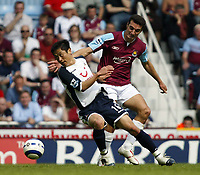 Photo: Chris Ratcliffe.<br /> West Ham United v Tottenham Hotspur. The Barclays Premiership. 07/05/2006.<br /> Lionel Scaloni (R) of West Ham tussles with Young-Pyo Lee.