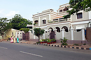 Maids walk to work past a period house, Pondicherry, India<br /> Pondicherry now Puducherry is a Union Territory of India and was a French territory until 1954 legally on 16 August 1962. The French Quarter of the town retains a strong French influence in terms of architecture and culture.