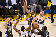 Golden State Warriors forward Andre Iguodala (9) and Golden State Warriors forward Draymond Green (23) battle New Orleans Pelicans forward Nikola Mirotic (3) for a loose ball at Oracle Arena during Game 2 of the Western Semifinals in Oakland, California, on May 1, 2018. (Stan Olszewski/Special to S.F. Examiner)