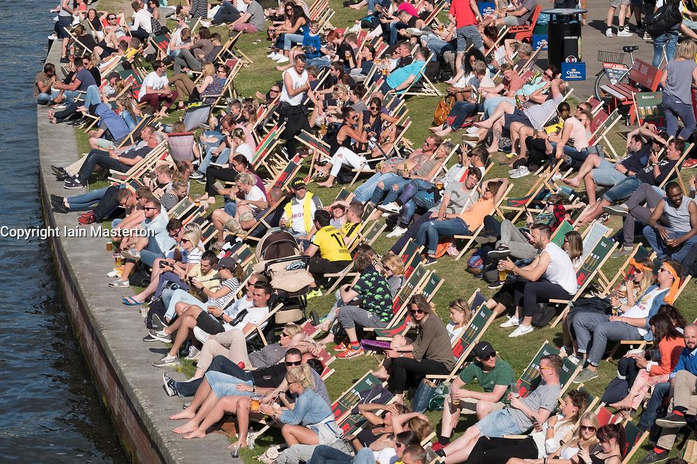 Outdoor riverside bar beside Spree River in summer in Berlin, Germany