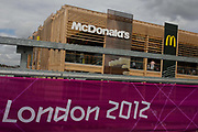 The world's biggest McDonald's in the Olympic Park during the London 2012 Olympics. or the past 40 years McDonalds has been the Official Restaurant Olympic Games. All official sponsors  they have paid $957 million to the IOC for the 19 days competition. Hundreds of food outlets at Olympic venues have been forced to take chips off the menu, because of a demand from sponsor McDonald's. Olympic chiefs banned all 800 food retailers at the 40 Games venues across Britain from dishing up chips because of 'sponsorship obligations. This land was transformed to become a 2.5 Sq Km sporting complex, once industrial businesses and now the venue of eight venues including the main arena, Aquatics Centre and Velodrome plus the athletes' Olympic Village. After the Olympics, the park is to be known as Queen Elizabeth Olympic Park.