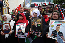 April 17, 2018 - Nablus, West Bank - Relatives of Palestinian prisoners jailed in Israeli prisons take part during a protest to demand for their release on the occasion of Palestinian Prisoners Day, in the West Bank city of Nablus. (Credit Image: © Shadi Jarar'Ah/APA Images via ZUMA Wire)