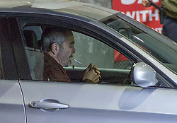 © Licensed to London News Pictures. 30/09/2021. London, UK. Actor James Nesbitt is seen sitting in a car smoking a cigarette as a film crew works at a petrol station in Vauxhall, central London filming Channel 4's 'Suspect' during the seventh day of the fuel crisis. It is being reported that the Texaco petrol station which closed for the filming was fully stocked. Photo credit: Marcin Nowak/LNP