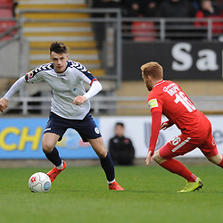 TELFORD COPYRIGHT MIKE SHERIDAN 16/3/2019 - Ryan Barnett of AFC Telford (on loan from Shrewsbury Town Football Club) steps clear of James Brophy of Orient during the FA Trophy semi final first leg fixture between Leyton Orient and AFC Telford United at Brisbane Road.